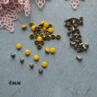Хольнитены 4 мм желтые. Основа серебро
