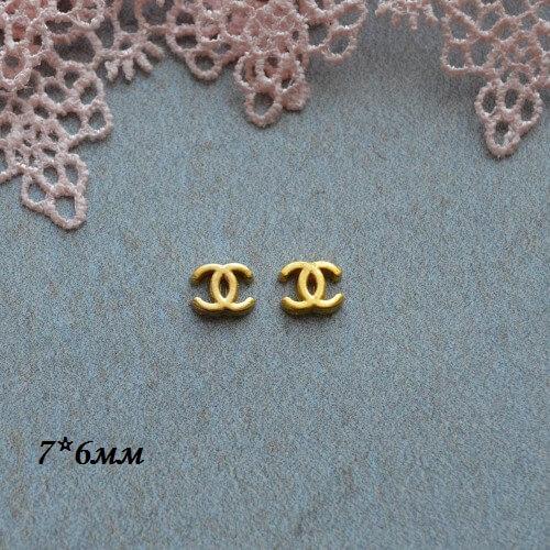 • Логотип Chanel золото. Размер 7*6 мм Цена указана за 2шт.