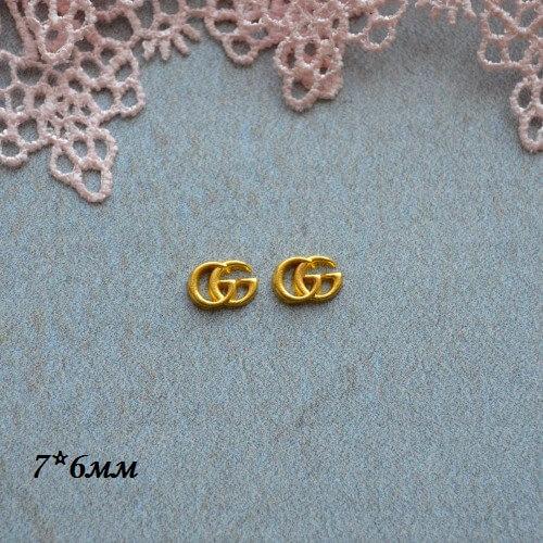 • Логотип Gucci серебро. Размер 7*6 мм Цена указана за 2шт.
